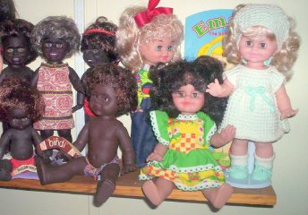 My small Netta and Metti dolls on a display shelf