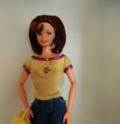 Gina was a Macy's Nicole Miller City Shopper doll from 1996.