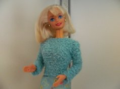Jill is one of the many blonde Barbies I bought in the late 90s and has been saved for make over projects.