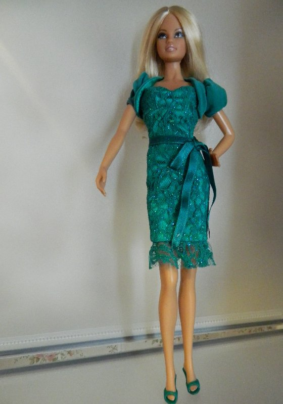 Joanne in a green cocktail dress.