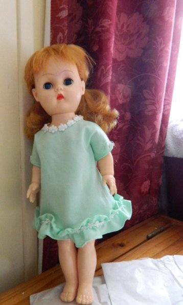 image dressed vinyl doll