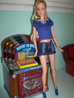 Kylie, a Fashion Fever doll from Wave U wears the denim shorts with a polka dot top.