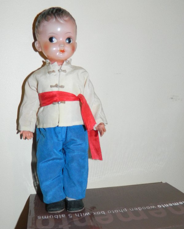 Boy doll with side glancing eyes.