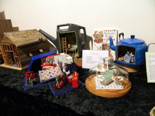 "A collection of miniatures on the theme of ""You don't need a dolls house."""