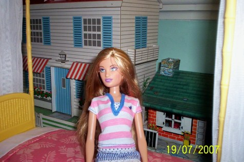 Pamela in horizontal stripe T-shirt with the skirt.