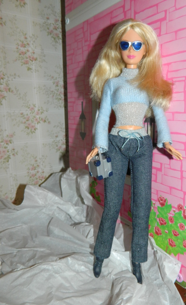 Rebecca lets her hair down in jeans with a blue jumper and black ankle boots.