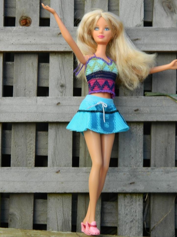 Rebecca wears the crochet halter top and netball skirt.