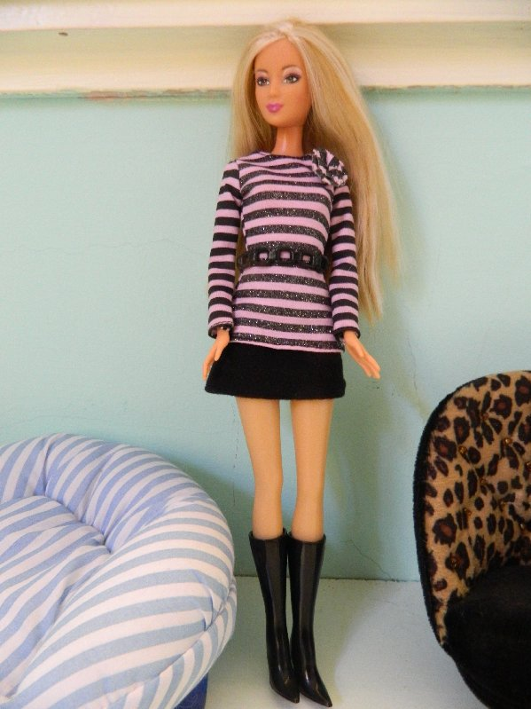 Mel in the striped top, skirt and boots.