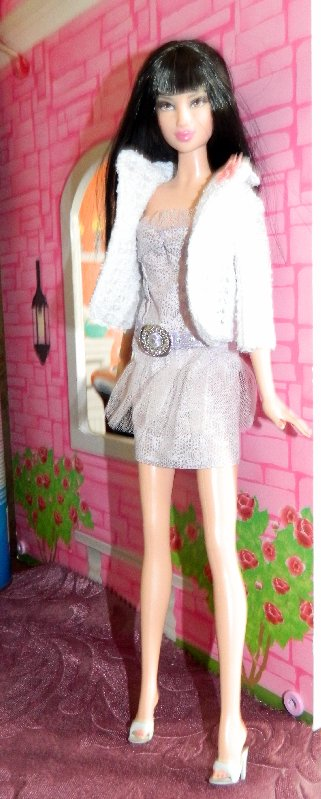 Nicola in the party dress and a white lacy knit jacket.