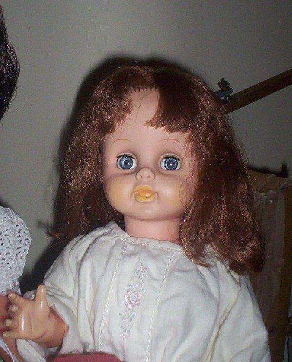 Mystery walking, talking doll.