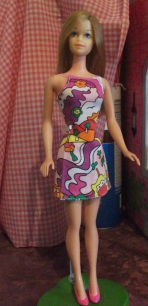 Vintage Barbie with TNT body marked Mattel 1966, and Made in Japan.