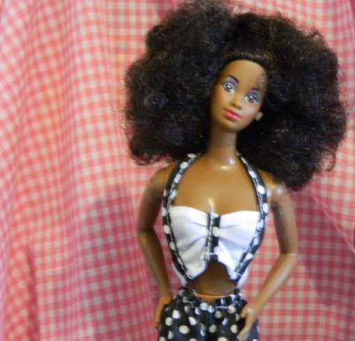 Dee Dee from Barbie and the Rockers. I think she is the 1986 doll.