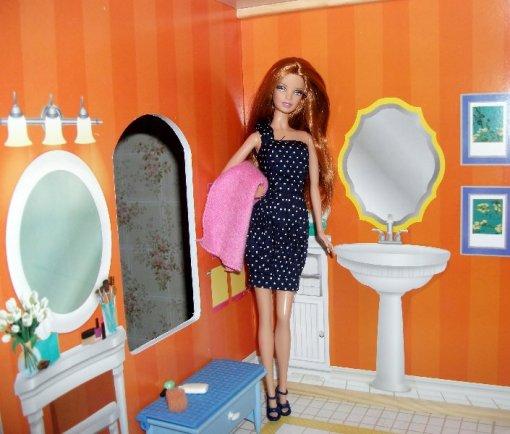 Black Basics Barbie 007 in the dolls house bathroom.