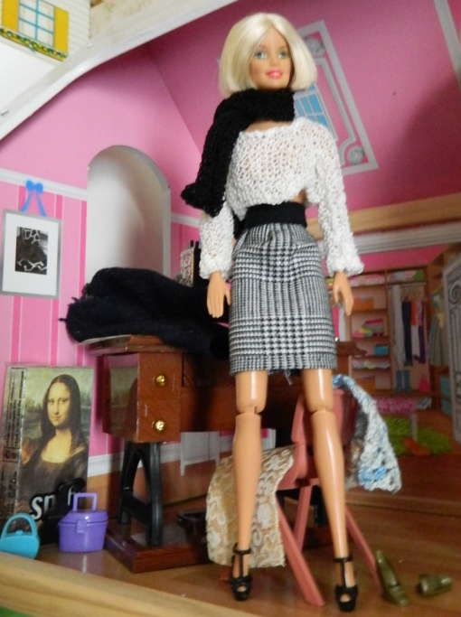 Midge in one of the skirts I made and a jumper and scarf I knitted.