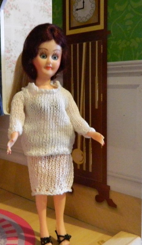 Wearing knitted clothes that were a bit snug on the Barbies.