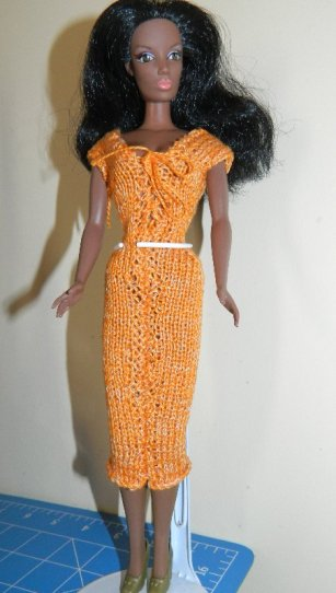 African American Candi by Hamilton Design Systerms wearing a hand knitted dress.