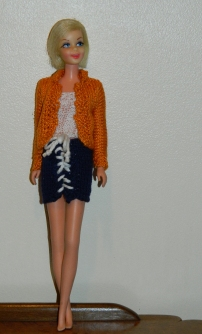 Casey in a hand-knitted outfit.