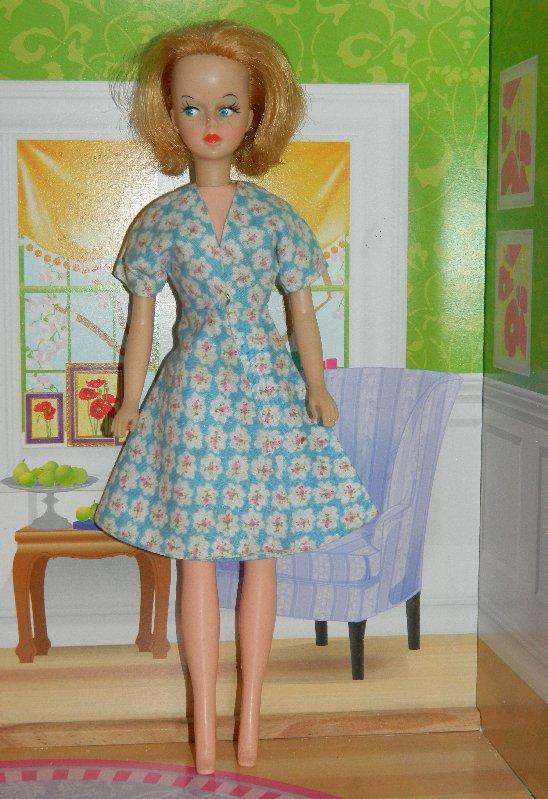 V Leg Tressy wears a blue cotton print dress.