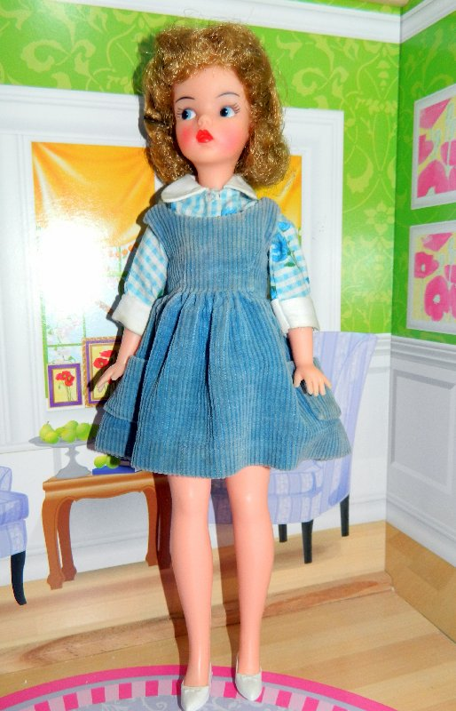 Canadian Tammy wears her new blue and white blouse with a Tammy pinafore dress.