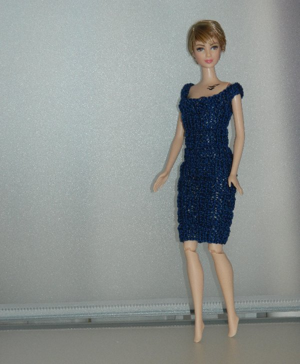 Tris in dress made from cotton perle yarn.