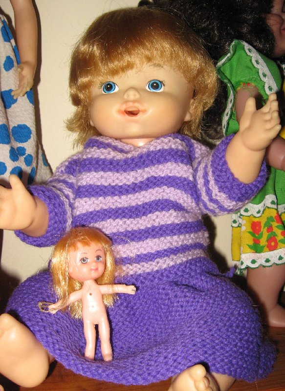 Baby Alive in knitted outfit