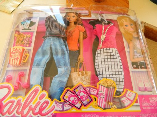 A pair of Barbie outfits.