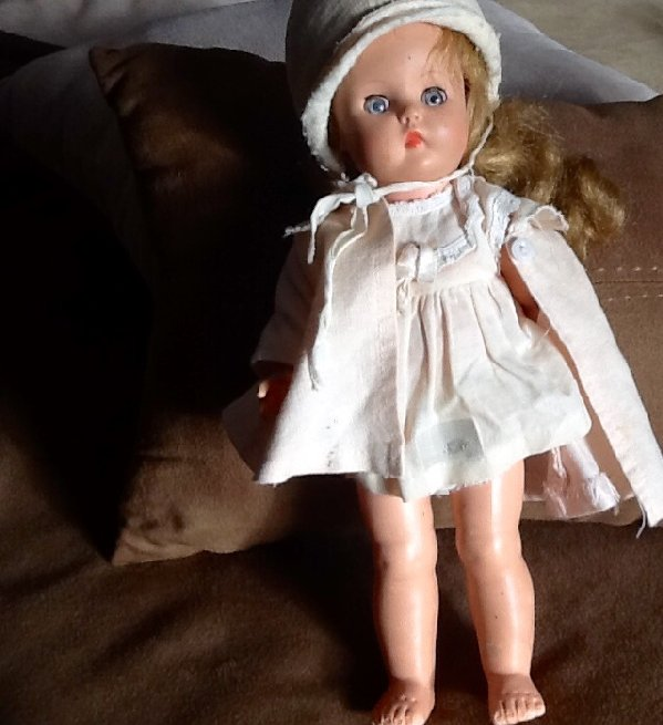 Susan's doll in vintage outfit which may be original