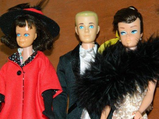 Midge with Ken and Barbie.