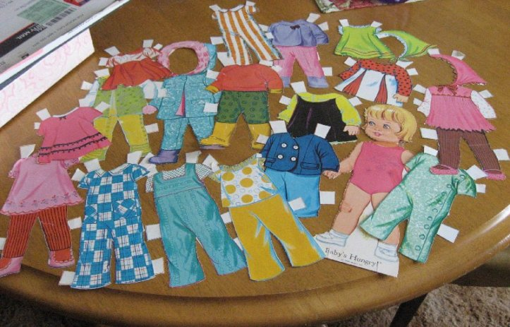 Baby's Hungry paper doll and her clothing.