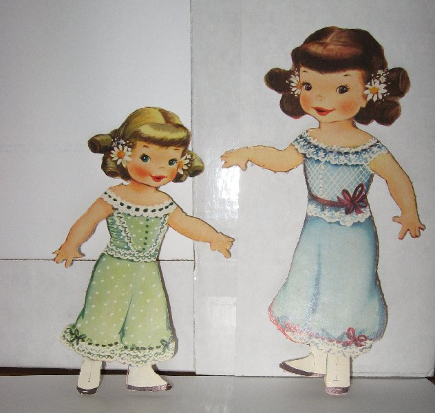 Two original dolls.