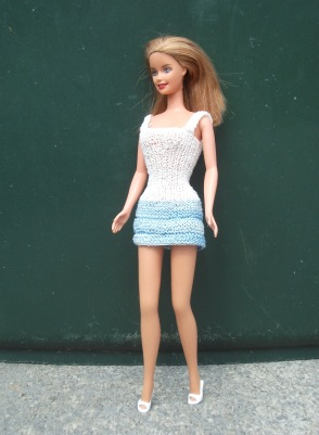 Jess wears a dress in blue and white cotton thread knitted by me.