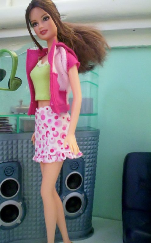 Fashon Fever -Floral skirt, light green top and a pink jacket.