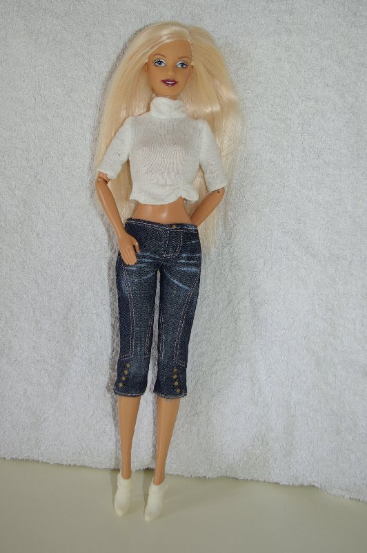 knit top, cropped jeans and boots