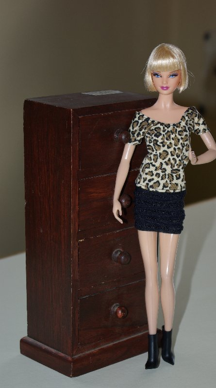 Becky poses with the chest of drawers.