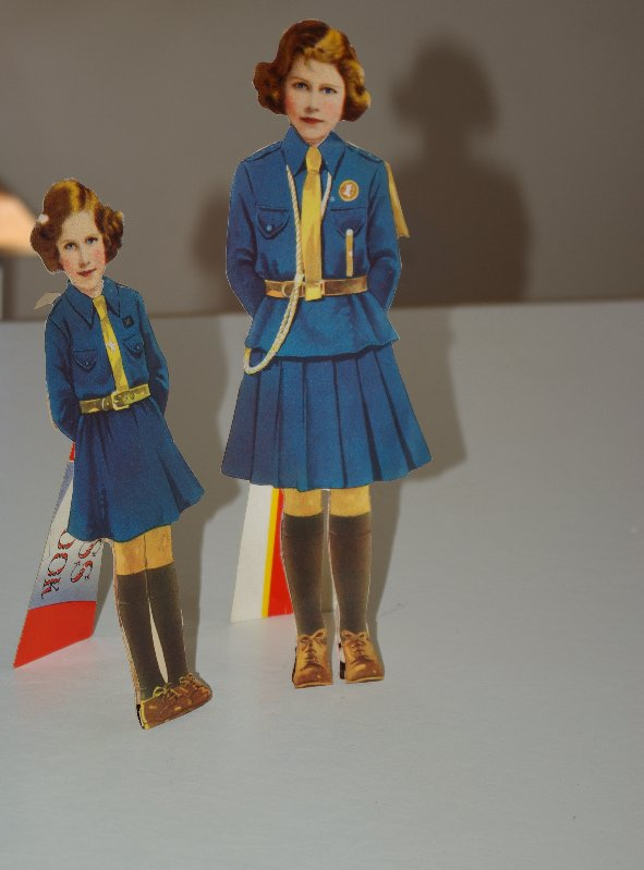 Princess paper dolls in Girl Guide uniforms.