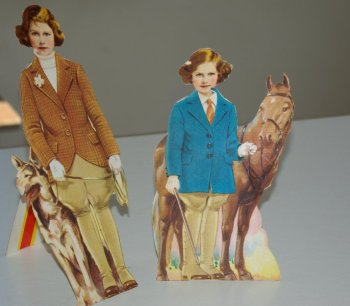 Princess paper dolls In their riding gear with dog and pony.