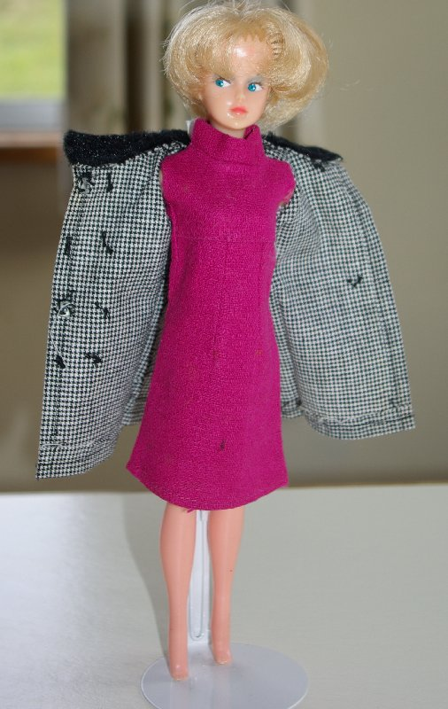 Tressy modelling a shift dress and double breasted coat.
