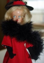 American Character Tressy in an OOAK red coat and matching hat .