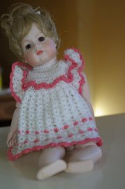 dsmall double jointed porcelain doll.
