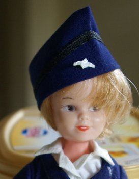 Tuppence in stewardess uniform
