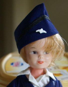 Tuppence in stewardess uniform
