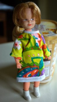 This doll is wearing a home made outfit from the mod era.