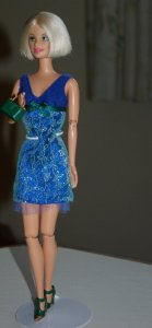 the blue dress with green and gold shoes and matching bag.