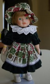 Porcelain doll from Copperart circa 1990s