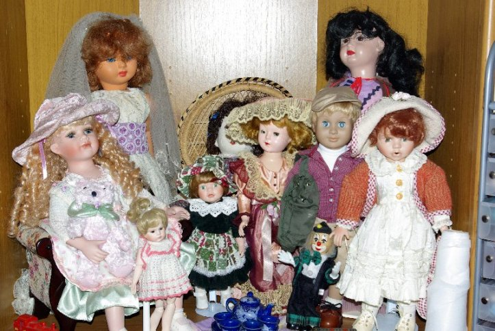 Bernice is settled into her new home with the other well-dressed dolls.