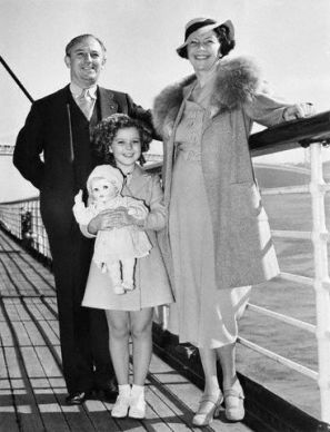 August 1937 --- Shirley Temple and her parents, Mr. and Mrs. George Temple, are pictured aboard the liner , sailing from San Francisco, for a vacation in Hawaii. --- Image by © Bettmann/CORBIS
