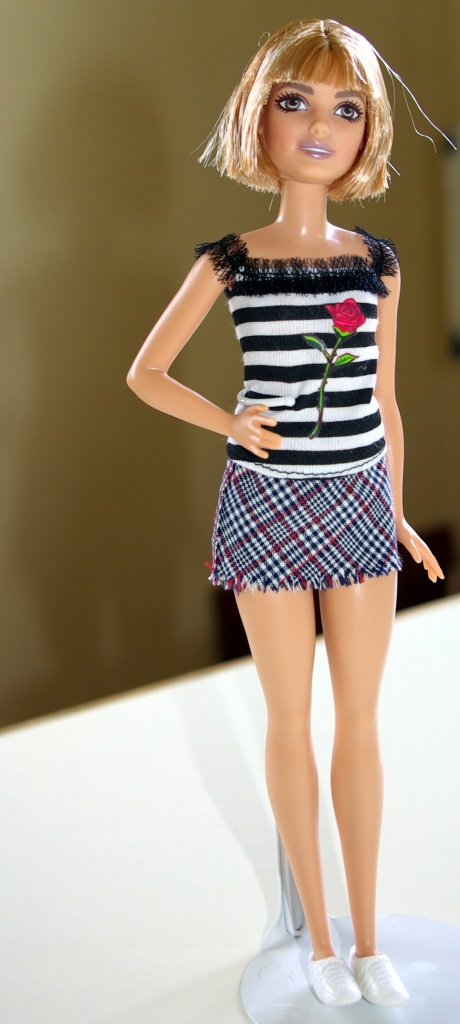 Mona wears the check skirt with the striped top.
