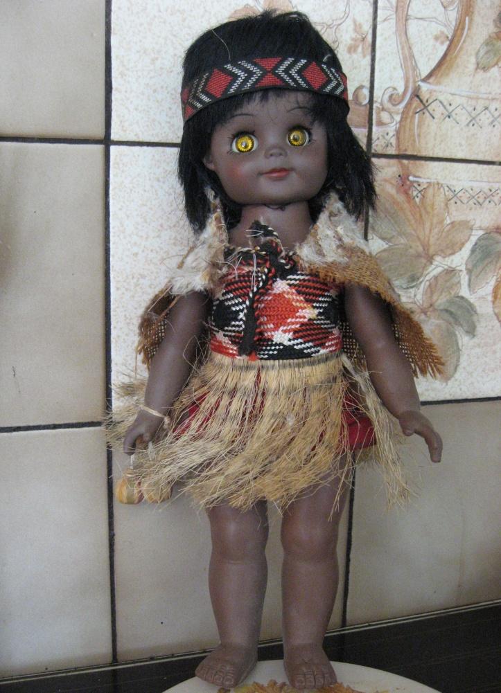 Doll dressed in Maori costume.