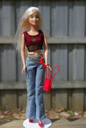 Lisa in the denim jeans and red/black crop top.