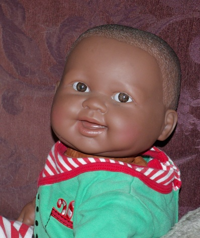 cloth bodied baby doll marked Berenguer.